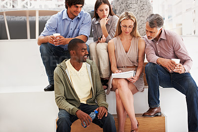 Buy stock photo A team of designers discussing some ideas