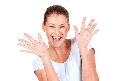 Buy stock photo A excited young woman gesturing with her hands while isolated on white