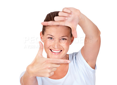 Buy stock photo A pretty young woman framing you with her hands while isolated on white