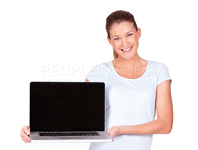 Buy stock photo A lovely young woman presenting a top of the line laptop to you - isolated