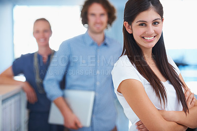 Buy stock photo Cropped shot of three coworkers standing in the office