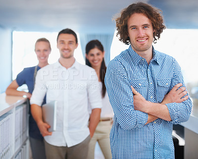 Buy stock photo Cropped shot of four coworkers standing in the office