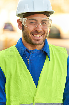 Buy stock photo Portrait of a construction worker wearing protective glasses and smiling at you