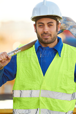 Buy stock photo Portrait of a construction worker with his shovel over his shoulder