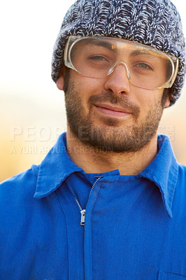 Buy stock photo Portrait of a construction worker wearing protective glasses