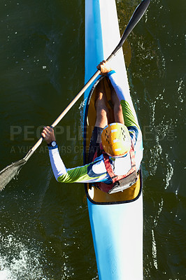 Buy stock photo A high angle shot of a man canoeing down a river
