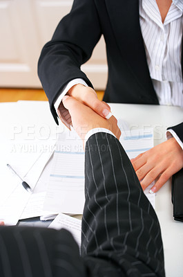 Buy stock photo Closing a deal with a handshake. Signed contract on the table.