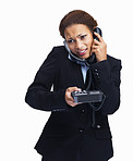 Businesswoman speaking over two telephones at the same time