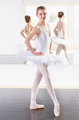 Buy stock photo Full length portrait of a young ballerina practicing in a dance studio