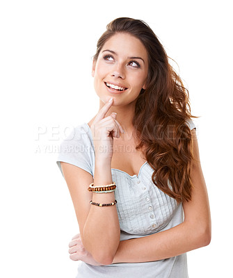 Buy stock photo A gorgeous young woman looking upwards while daydreaming