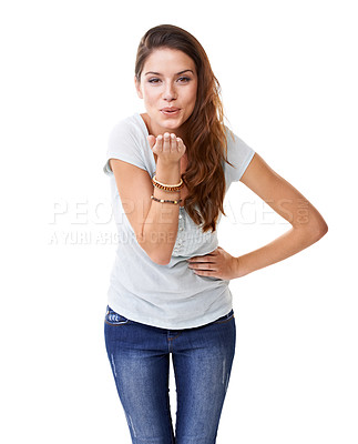 Buy stock photo A beautiful young woman blowing a kiss at the camera