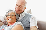 Relaxed smiling senior man and woman sitting on couch at home