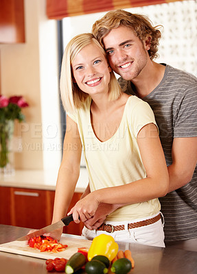 Buy stock photo Portrait of a young couple cooking in the kitchen