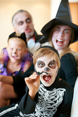 Buy stock photo A cute family dressed up for Hallowe'en screaming at the camera