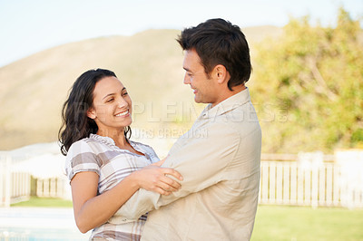 Buy stock photo A loving couple enjoying the outdoors together