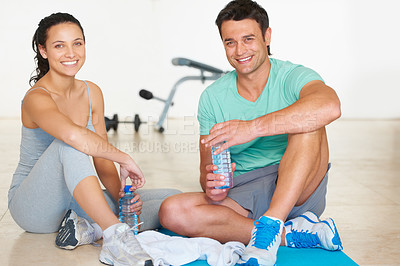 Buy stock photo A young couple taking a break from exercizing