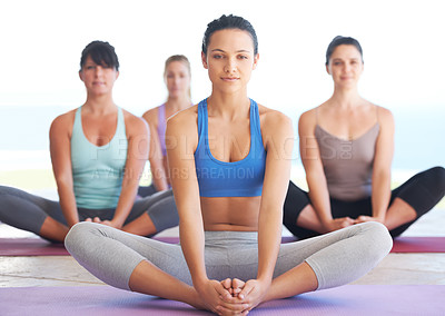 Buy stock photo Group of serene yoga practitioners meditating together