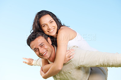 Buy stock photo An attractive young couple being playful outside