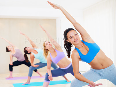 Buy stock photo Young pilates instructor leading a class