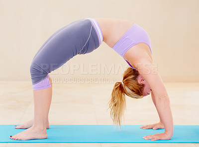 Buy stock photo Skilled yoga practitioner performing a yoga position