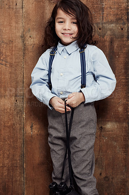 Buy stock photo Shot of a stylish young boy posing in the studio