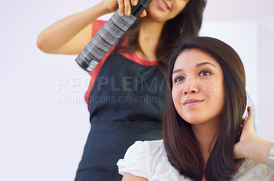 Buy stock photo Cropped shot of an attractive young woman in the hair salon