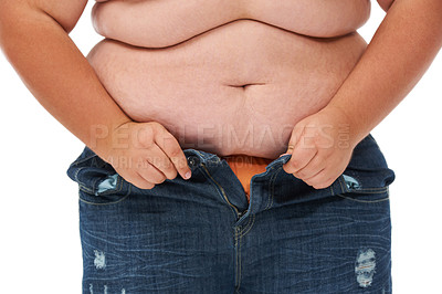 Buy stock photo Cropped midsection of an obese man trying to close the buttons of his jeans against a white background