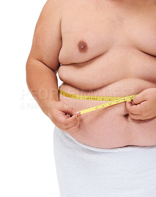 Buy stock photo Cropped midsection of an obese man measuring his waist with a measuring tape against a white background