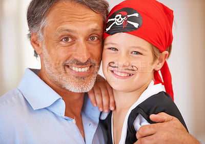 Buy stock photo Portrait of a father with his son who is dressed up as a pirate