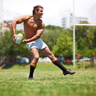 Buy stock photo Full length shot of a shirtless young rugby player executing a pass