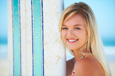Buy stock photo Portrait of a pretty blonde with her surfboard on the beach