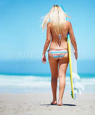 Buy stock photo Beautiful blonde in a bikini walking on the beach with her surf board - back view