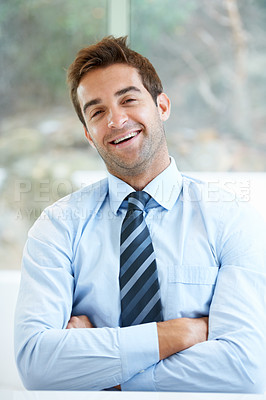 Buy stock photo Cropped shot of a handsome young businessman at work