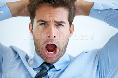 Buy stock photo Portrait of a young businessman shouting with hands behind his head