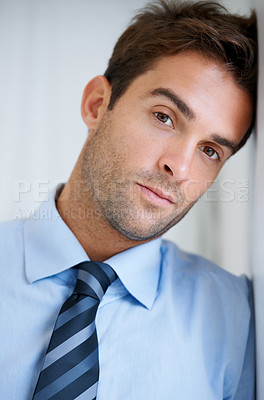Buy stock photo Portrait of a businessman leaning against a wall