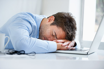 Buy stock photo A businessman asleep on his laptop on his desk at  work