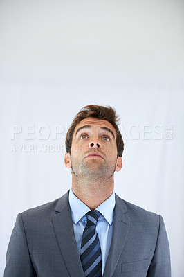 Buy stock photo A business man standing and looking up with copy space