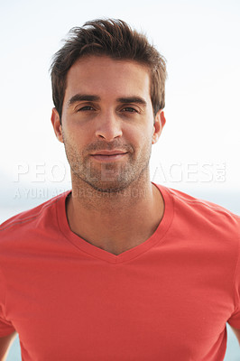 Buy stock photo Portrait of a handsome young man wearing a red t-shirt