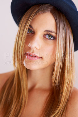 Buy stock photo Shot of an stylish and attractive young woman