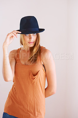 Buy stock photo A stylish young woman posing with a hat