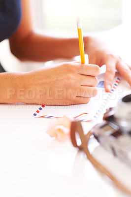 Buy stock photo Cropped view of a woman's hands writing an address on an envelope