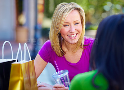 Buy stock photo Two young woman stopping for lunch while out shopping