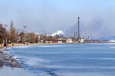 Buy stock photo Shot of industrial buildings along the waters edge
