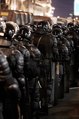 Buy stock photo The army barricading a riot in the city