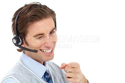 Buy stock photo A young man wearing a headset and winking and pointing at you