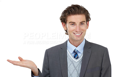 Buy stock photo A young businessman holding up your product while isolated on a white background