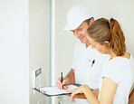 A female speaking to an electrician