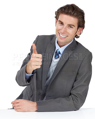 Buy stock photo A stylish young businessman showing you a thumbs up while isolated on white