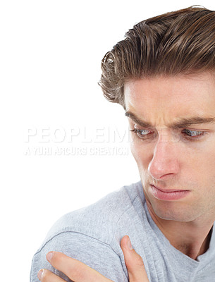 Buy stock photo Unimpressed young man looking over his shoulder