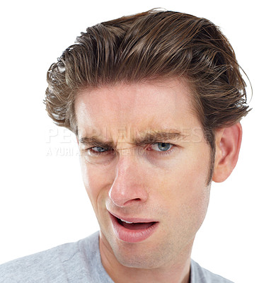Buy stock photo Young man looking at the camera with an expression of disgust
